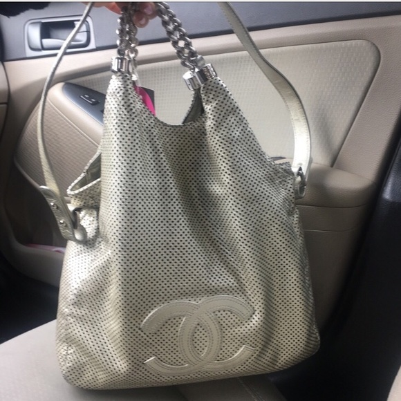 24e9c79b4584 CHANEL Handbags - 💯 CHANEL Metallic Perforated Rodeo Drive Silver